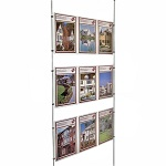 Triple A4P poster holders on wires as estate agent window display